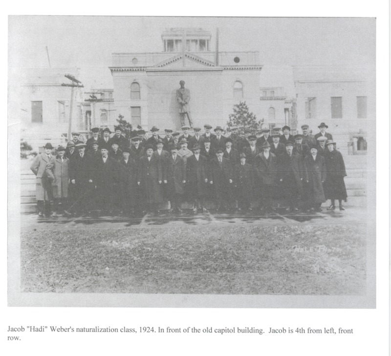 "Jakob ""Hadi"" Weber's naturalization class, 1924 standing in front of the old Capitol Building. Jakob is 4th from left, front row."