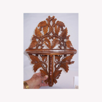 Rose Garey Discussing A Mahogany Decorative Piece